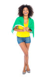 Pretty girl in yellow tshirt and brazilian flag smiling at camera Stock Photos