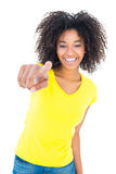 Pretty girl in yellow tshirt and denim hot pants smiling at camera Royalty Free Stock Photos