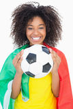 Pretty girl in yellow tshirt holding football Royalty Free Stock Images