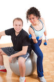 Pretty girl and young man fitness exercising Stock Photography