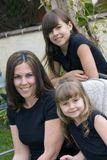 Pretty girls. A pretty woman with her two cute daughters royalty free stock photography