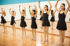 Pretty girls in a ballet dance class. Group of girls practicing some ballet in a dance class at school royalty free stock images