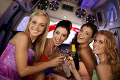 Pretty girls celebrating in limo Royalty Free Stock Image