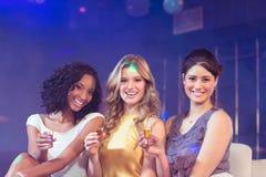 Pretty girls celebrating Royalty Free Stock Images