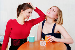 Pretty girls chatting with coffee Royalty Free Stock Photos