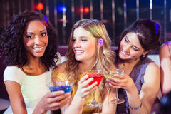 Pretty girls with cocktails. In a club Stock Photos