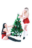 Pretty girls decorating Christmas tree Stock Images