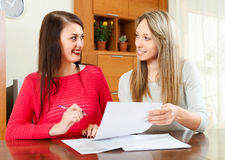 Pretty girls with  documents Stock Photos