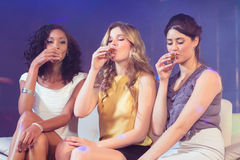 Pretty girls drinking alcohol Stock Images