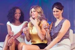 Pretty girls drinking alcohol Royalty Free Stock Photo