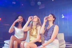 Pretty girls drinking alcohol Royalty Free Stock Photos