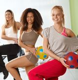 Pretty girls exercising with ball Royalty Free Stock Images