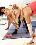 Pretty girls exercising bending Stock Photography