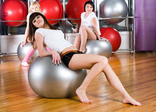 Pretty girls in fitness center Stock Images