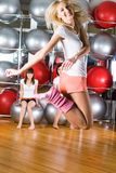 Pretty girls in fitness center Stock Image