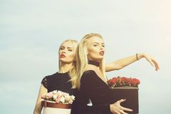 Pretty girls with flowers in box stock photo