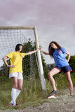 Pretty girls in the football field Stock Photography