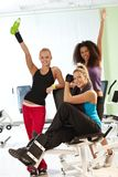 Pretty girls at the gym. Pretty girls posing and smiling at the gym Royalty Free Stock Images