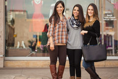 Pretty girls hanging out at a shopping mall Royalty Free Stock Photo