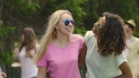 Pretty girls having fun at party, dancing to music with friends, taking selfie. Stock footage stock footage