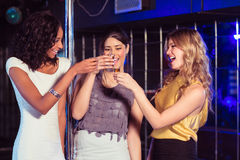 Pretty girls having shots. In a nightclub Royalty Free Stock Photography