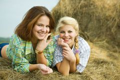 Pretty girls on hay Royalty Free Stock Photography