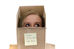 Pretty girls head sticking out of the box Royalty Free Stock Photo