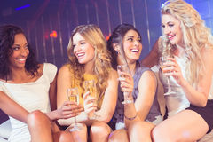 Pretty girls holding champagne glass Royalty Free Stock Images