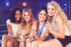 Pretty girls holding champagne glass Stock Photography