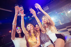 Pretty girls holding champagne glass Royalty Free Stock Photography
