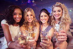 Pretty girls holding champagne glass Royalty Free Stock Photos