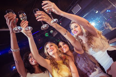 Pretty girls holding champagne glass. In a nightclub Stock Photo