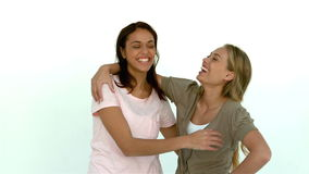 Pretty girls hugging and laughing. In slow motion stock video
