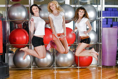 Pretty girls jump in fitness center Royalty Free Stock Photo