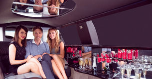 Pretty girls with ladies man in the limousine Royalty Free Stock Images