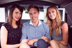 Pretty girls with ladies man in the limousine Stock Photos