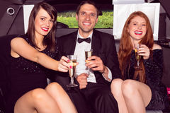 Pretty girls with ladies man in the limousine. Pretty girls with ladies men in the limousine on a night out Royalty Free Stock Photo