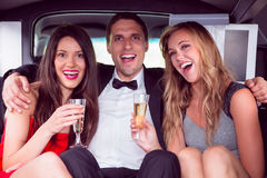 Pretty girls with ladies man in the limousine Stock Images