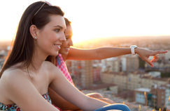 Pretty girls looking at the views in the city. Royalty Free Stock Photos