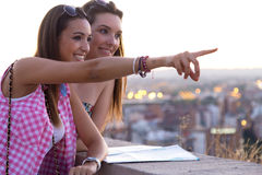 Pretty girls looking at the views in the city. Stock Photography