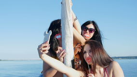 Pretty girls make selfie on a yacht - party and bachelorette party.  stock video