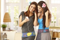 Pretty girls with mp3 player Royalty Free Stock Image