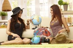 Pretty girls planning summer holiday Royalty Free Stock Image