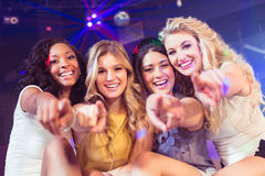 Pretty girls pointing with finger Stock Images