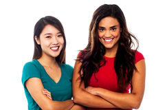 Pretty girls posing with arms crossed Stock Photos