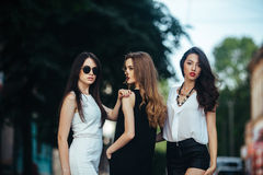 Pretty Girls Posing In A City Street Stock Photo