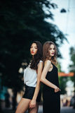 Pretty Girls Posing In A City Street Stock Photos