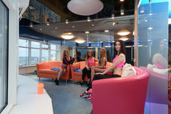 Pretty girls posing in recreation room at gym Royalty Free Stock Photo