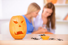Pretty girls preparing for Halloween party Royalty Free Stock Photography