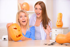 Pretty girls preparing for Halloween party Royalty Free Stock Photos